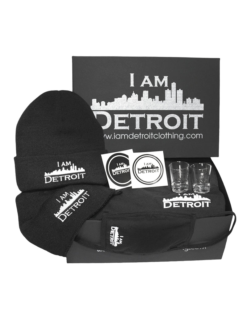 Keeping Warm in the D Gift Box is a Stylish Black Box containing 1 Underneath-It-All Long Sleeve Tee (Small Logo on left chest) with your choice of size, 1 Turn-Up-The Heat Knit Hat, 1 Wrap-It-Up Knit Scarf, 1 Keep-It-To-Yourself Face Covering, 2 Devastation-Destroyer Shot Glasses, 2 Reppin' Black and White Polarity Stickers