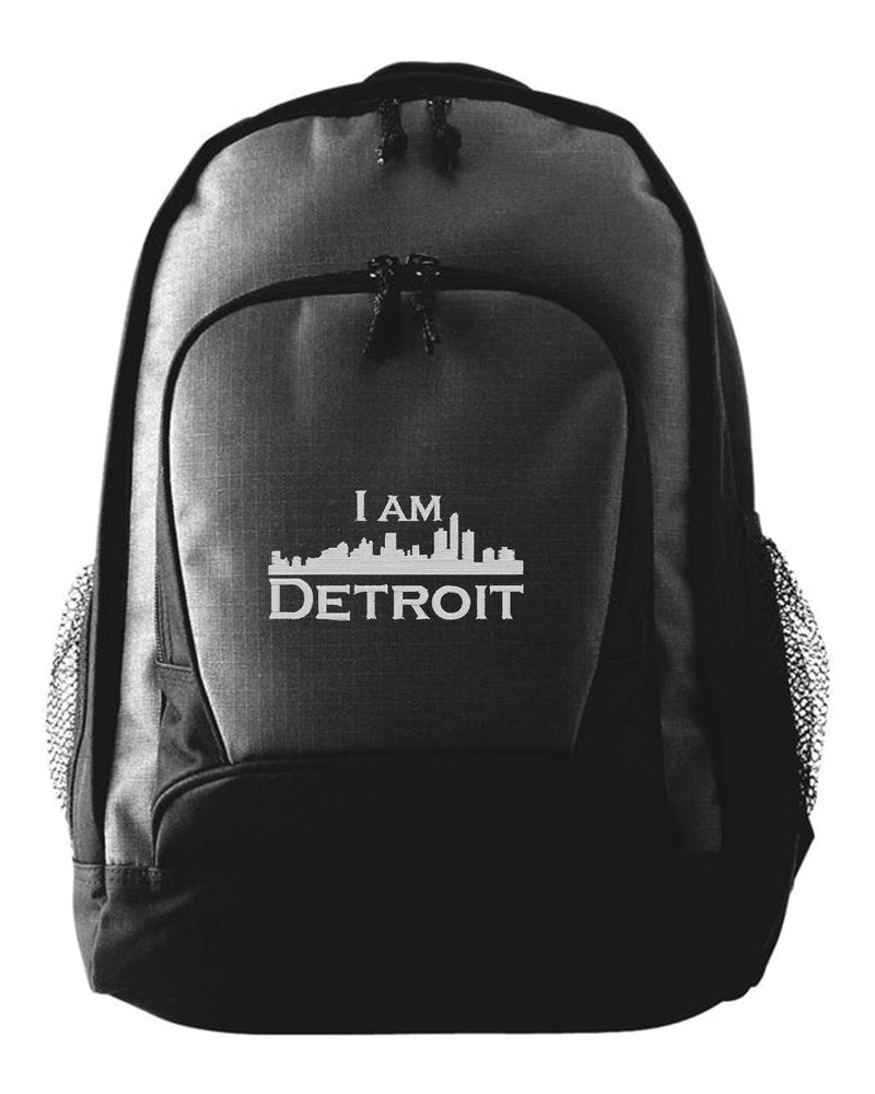 Black Backpack with gray stitched IAD logo embroidered on the front flap of smaller pouch.