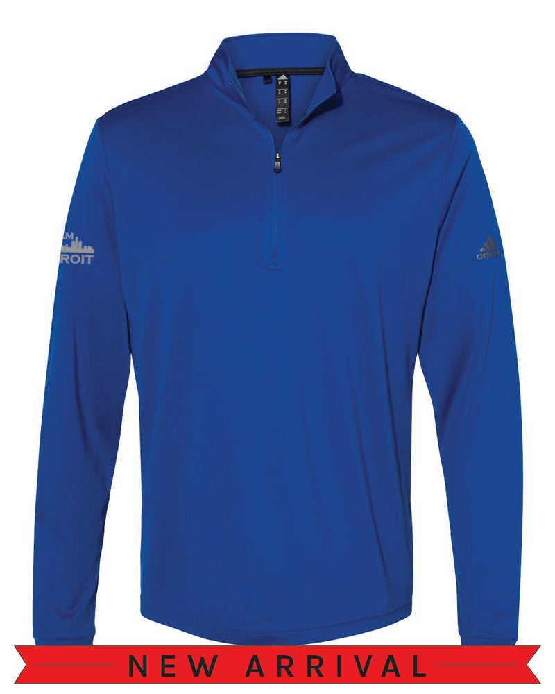 Front view of a Collegiate Royal Blue Cool Down Quarter-Zip Adidas long-sleeve pull over featuring a grey Adidas logo on the left arm and a grey I Am Detroit logo on the right arm
