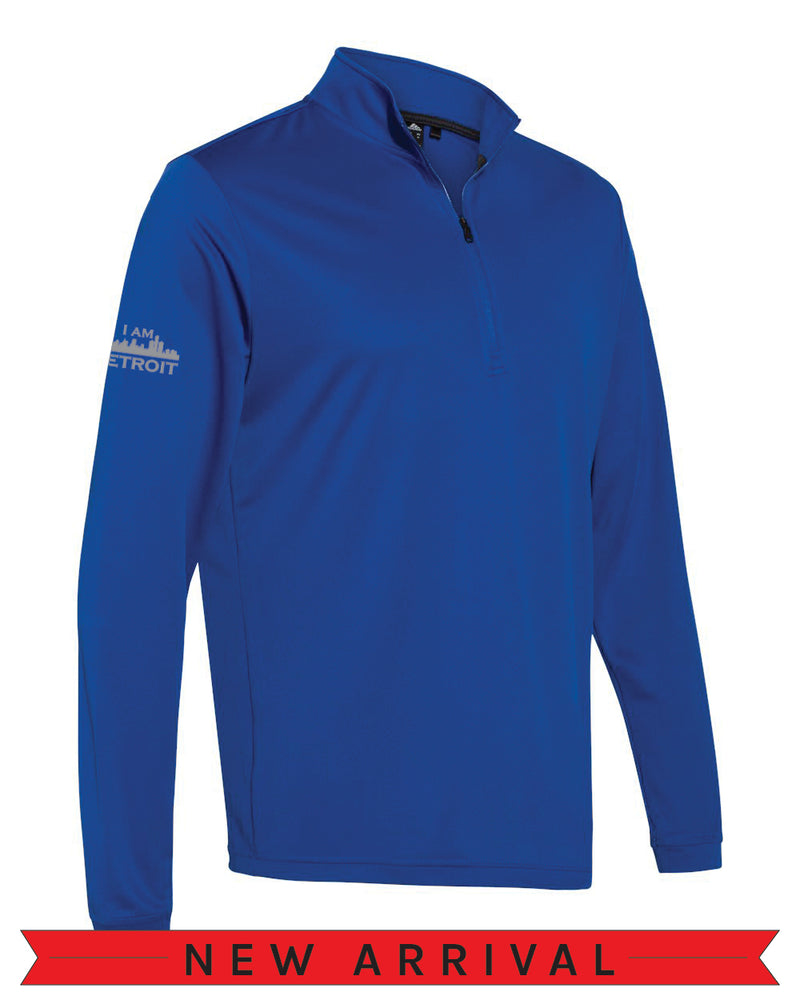 Angled side view of a Collegiate Royal Blue Cool Down Quarter-Zip Adidas long-sleeve pull-over featuring a grey I Am Detroit logo on the right arm