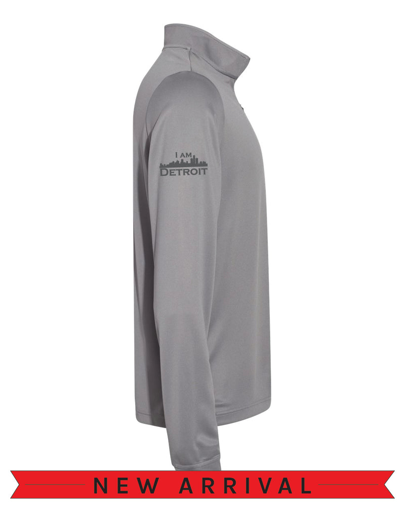 Direct side view of a Grey Cool Down Quarter-Zip Adidas long-sleeve pull-over featuring a grey I Am Detroit logo on the right arm