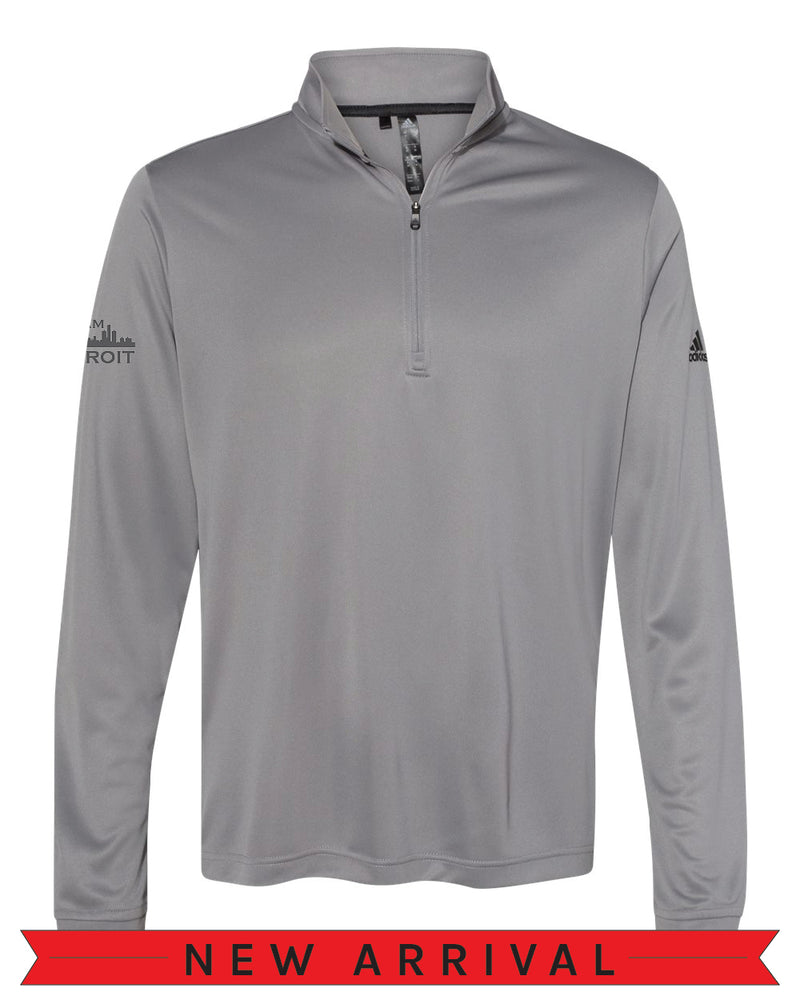 Front view of a Grey Cool Down Quarter-Zip Adidas long-sleeve pull over featuring a black Adidas logo on the left arm and a dark grey I Am Detroit logo on the right arm