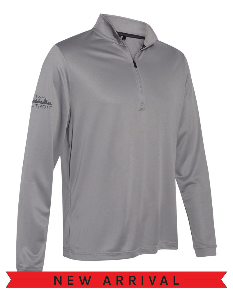 Angled side view of a Grey Cool Down Quarter-Zip Adidas long-sleeve pull-over featuring a dark grey I Am Detroit logo on the right arm