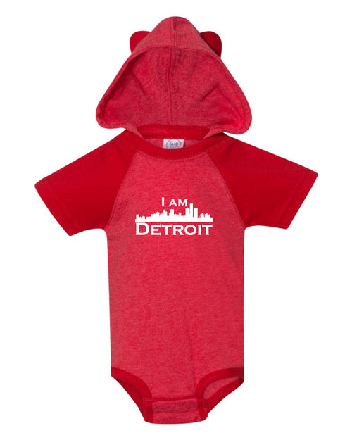 Adorable cozy red colored onsie with small white I Am Detroit logo printed across the front
