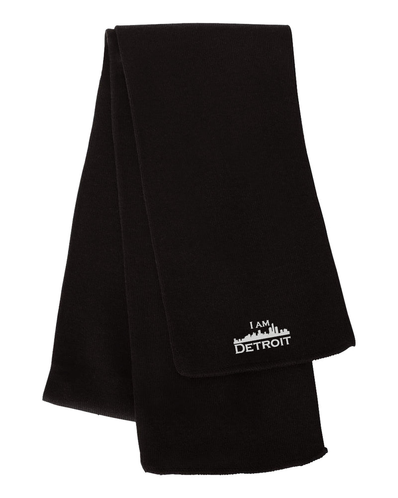 Black Wrap-It-Up Knit Scarf with white I Am Detroit logo embroidered on the end.