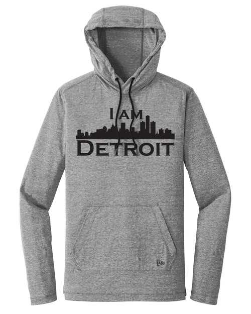 Heather gray long sleeve hooded t-shirt with kanga pouch and black drawstring cords large black I Am Detroit logo printed across the chest