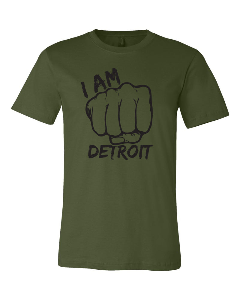 Olive colored t-shirt with giant fist surrounded by the words I Am Detroit