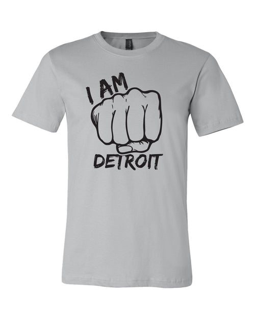 Gray t-shirt with giant fist surrounded by the words I Am Detroit