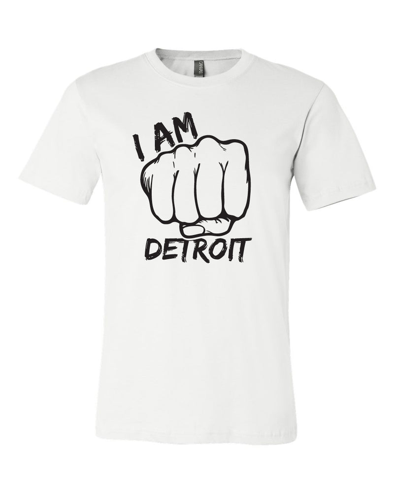 White t-shirt with giant fist surrounded by the words I Am Detroit