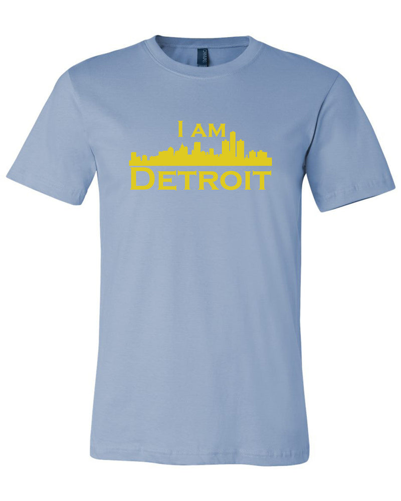 Baby blue short sleeve t-shirt with large yellow I Am Detroit logo printed across the chest
