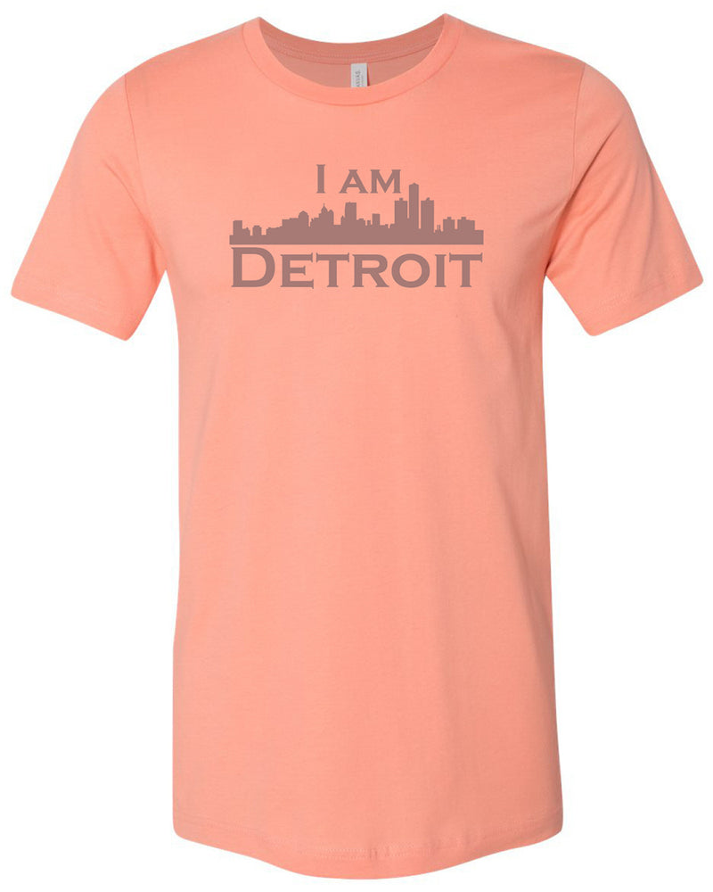 Sunset colored short sleeve t-shirt with large gray I Am Detroit logo printed across the chest