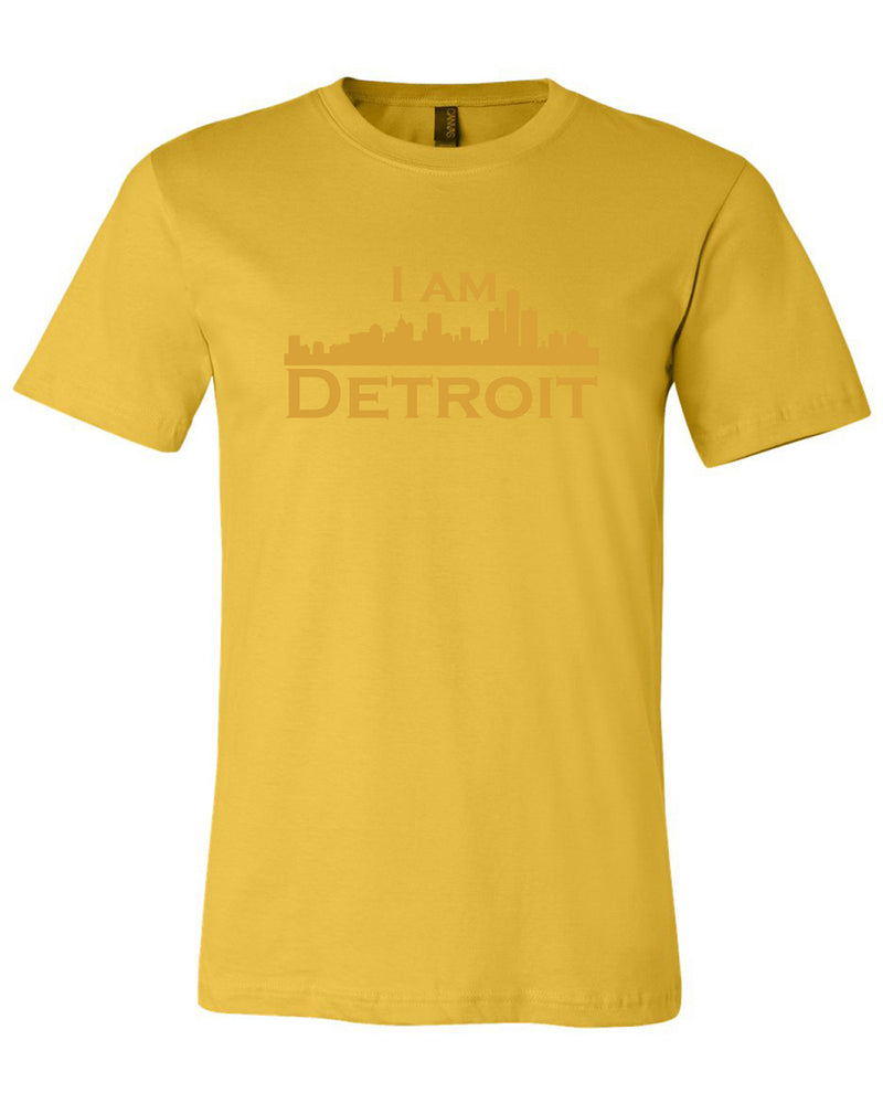 Maize colored short sleeve t-shirt with large maize I Am Detroit logo printed across the chest