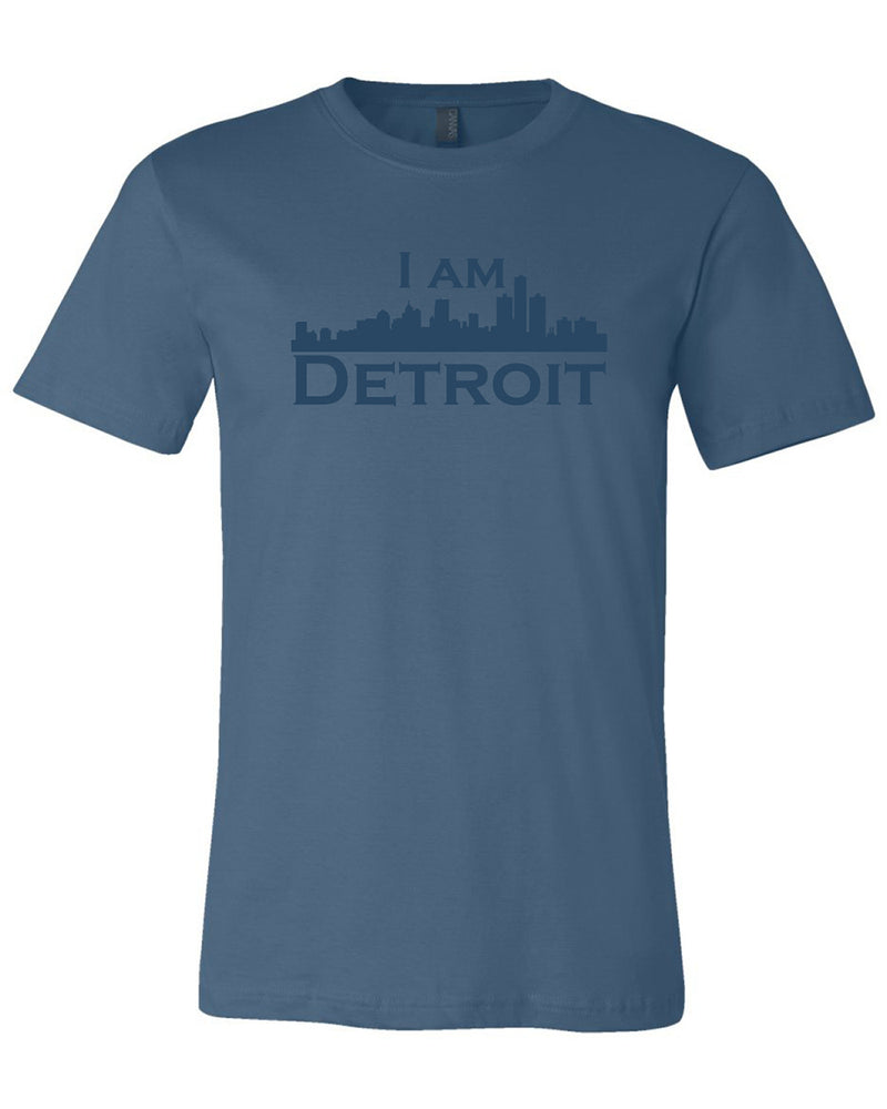 Steel navy colored short sleeve t-shirt with large steel navy colored I Am Detroit logo printed across the chest