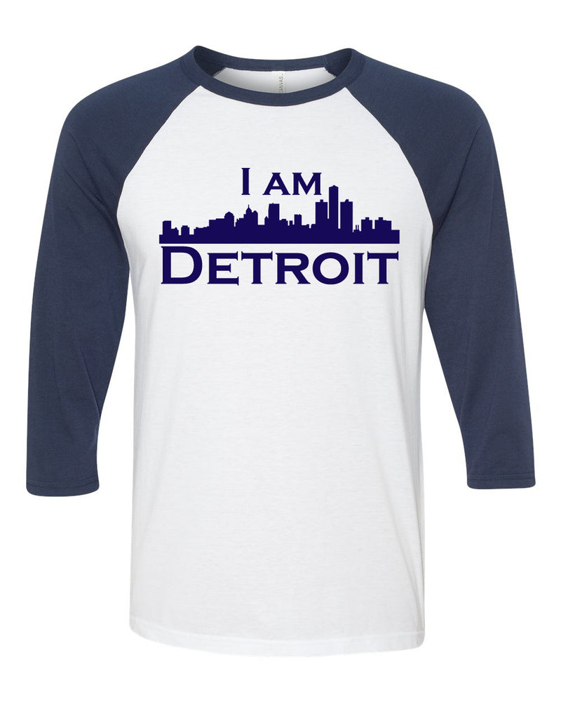 white raglan jersey with navy 3/4 sleeves and navy I Am Detroit logo across the front of t-shirt