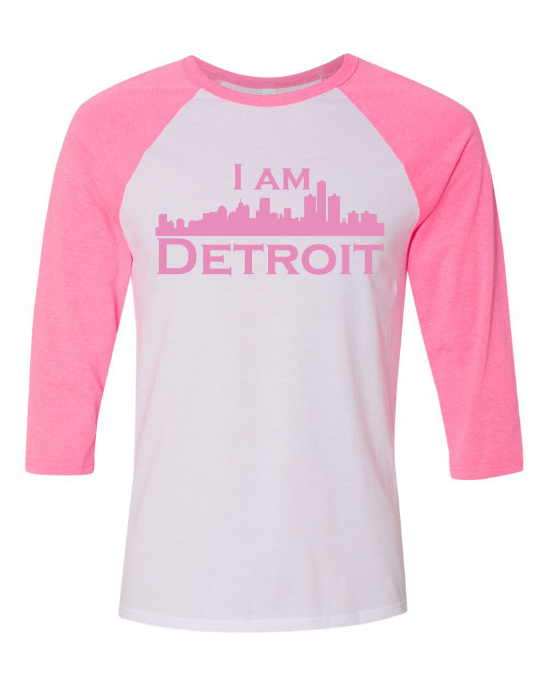 white raglan jersey with pink 3/4 sleeves and pink I Am Detroit logo across the front chest