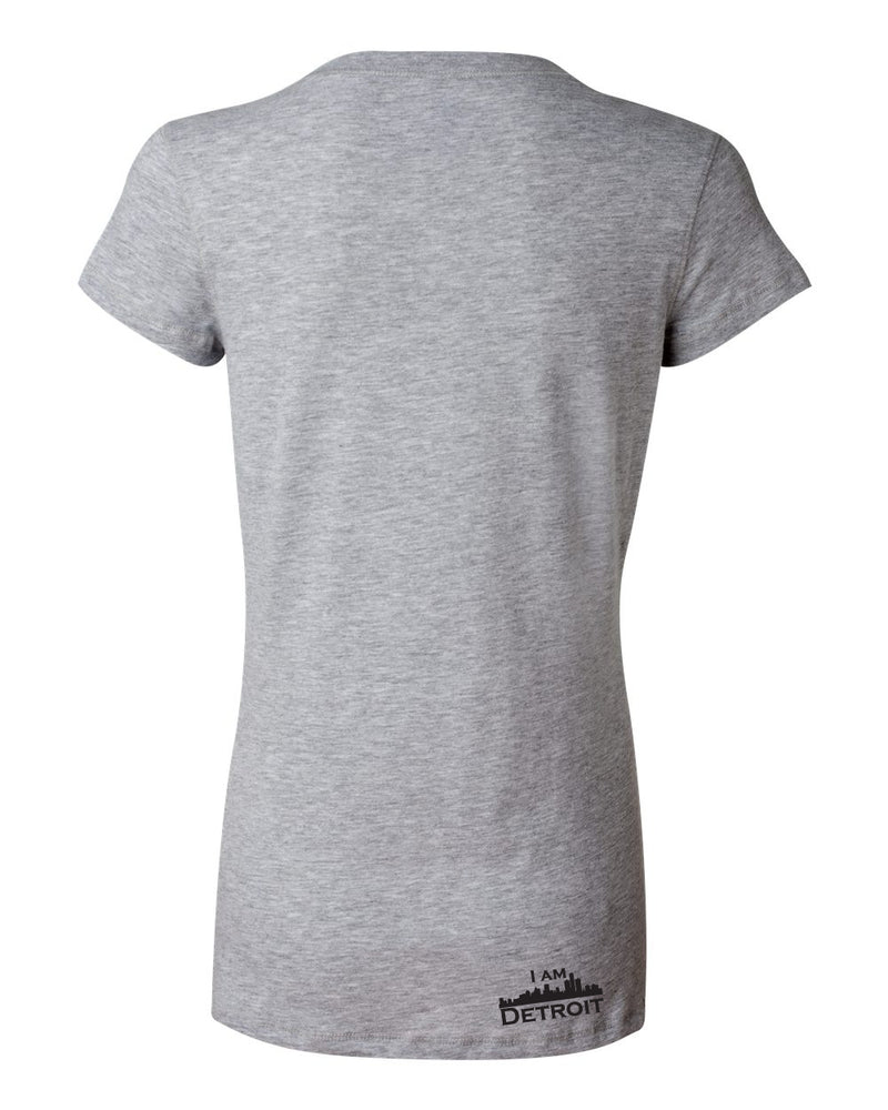 Back view of heather gray v-neck t-shirt with small black logo at bottom right near hem