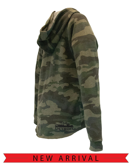 Backside view of soft fleece Camouflage patterned women's I Am Detroit apparel hooded long sleeve sweatshirt with cuffed sleeves featuring a small black I Am Detroit logo on the right bottom near the hem