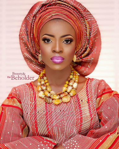 Nigerian Yoruba bride in burnt orange aso oke