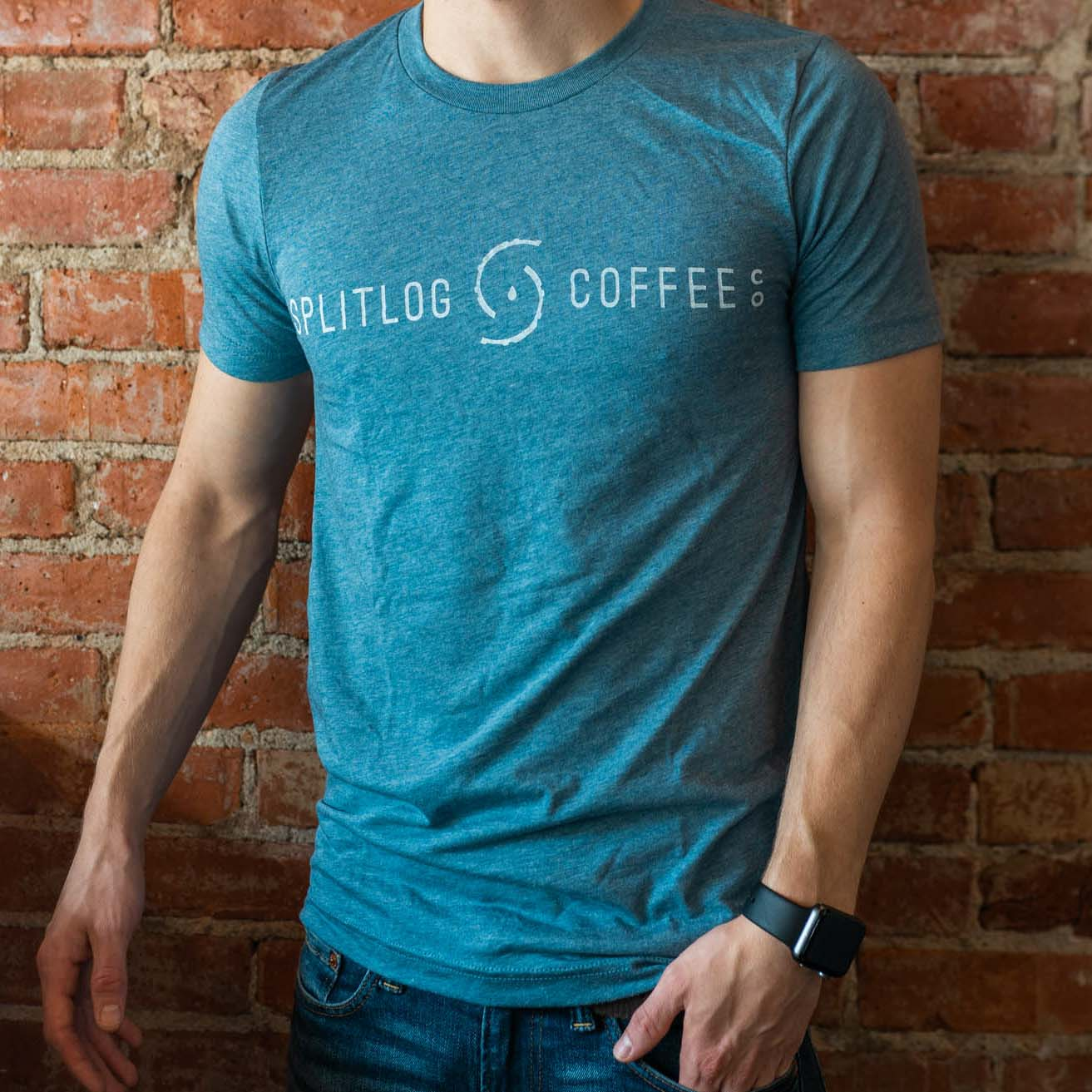 Triblend t-shirt with our official logo across the chest. This t-shirt comes in blue and charcoal heathered color pattern. True to size.  50% Polyester 25% Algodon 25% Rayon
