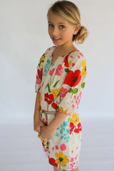 Oversized Poppy Print with rainbow belt Girls Elsa Dress by Pink Chicken on model