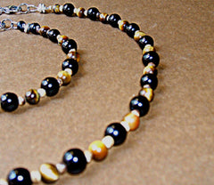 This is our Onyx and Tigers Eye Necklace