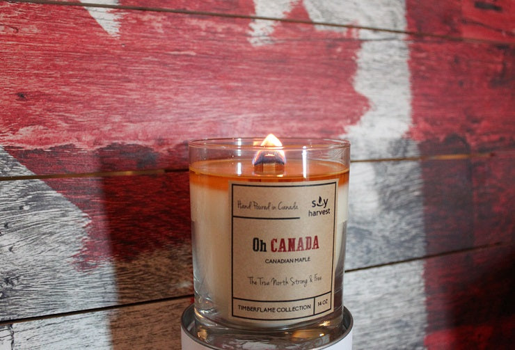 Oh Canada Candle in front of Canadian Maple Leaf