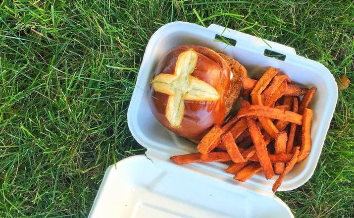 bartlebys sandwich and fries in box on grass