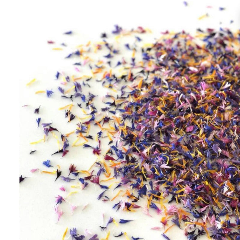 Edible Dried Flower Petals spilling out of a jar