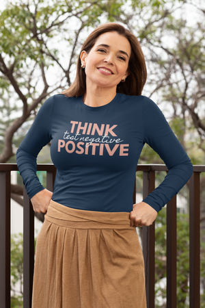 Think Positive Test Negative Long Sleeve T Shirt on white woman outdoor