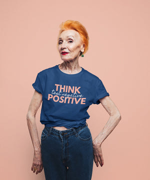 Think Positive Test Negative Blue T Shirt on older woman red hair studio shot