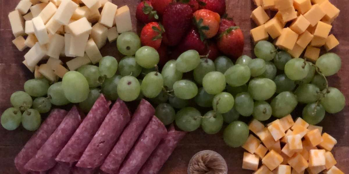 charcuterie spread for movie night example cheeseboard cheese cubes white grapes red grapes