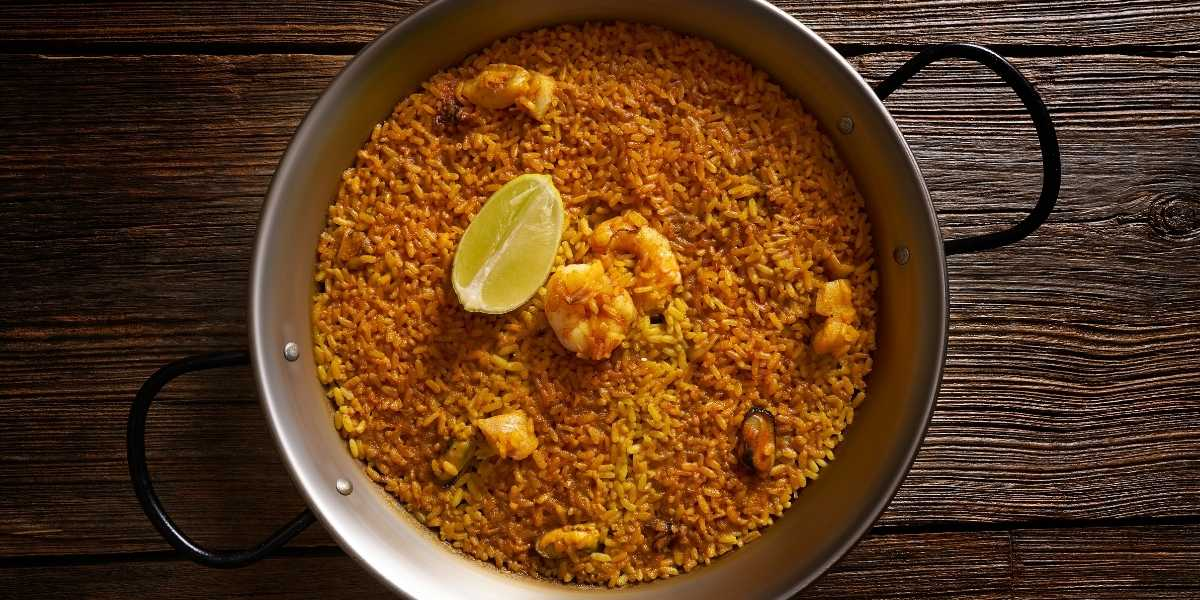 paella in a paella pan with socarrat formed