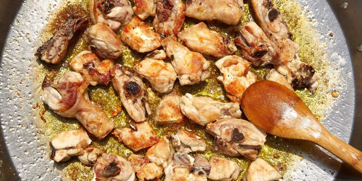 Rabbit meat for traditional paella cooking in paella pan