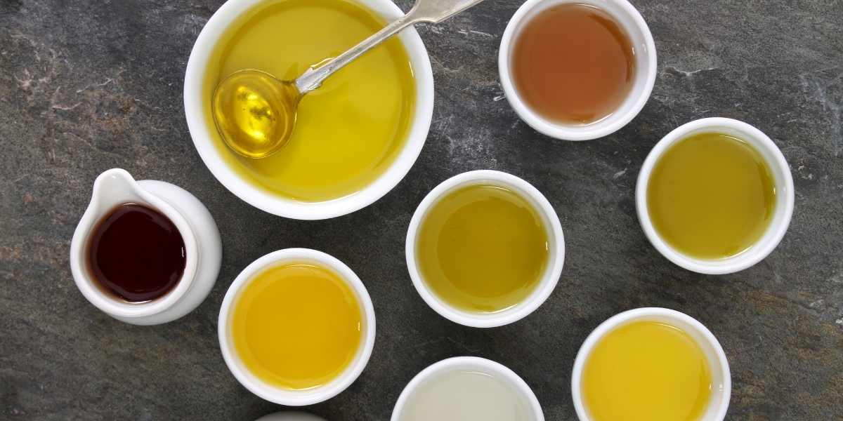 selection of cooking oils in china cups machika paella types of oil