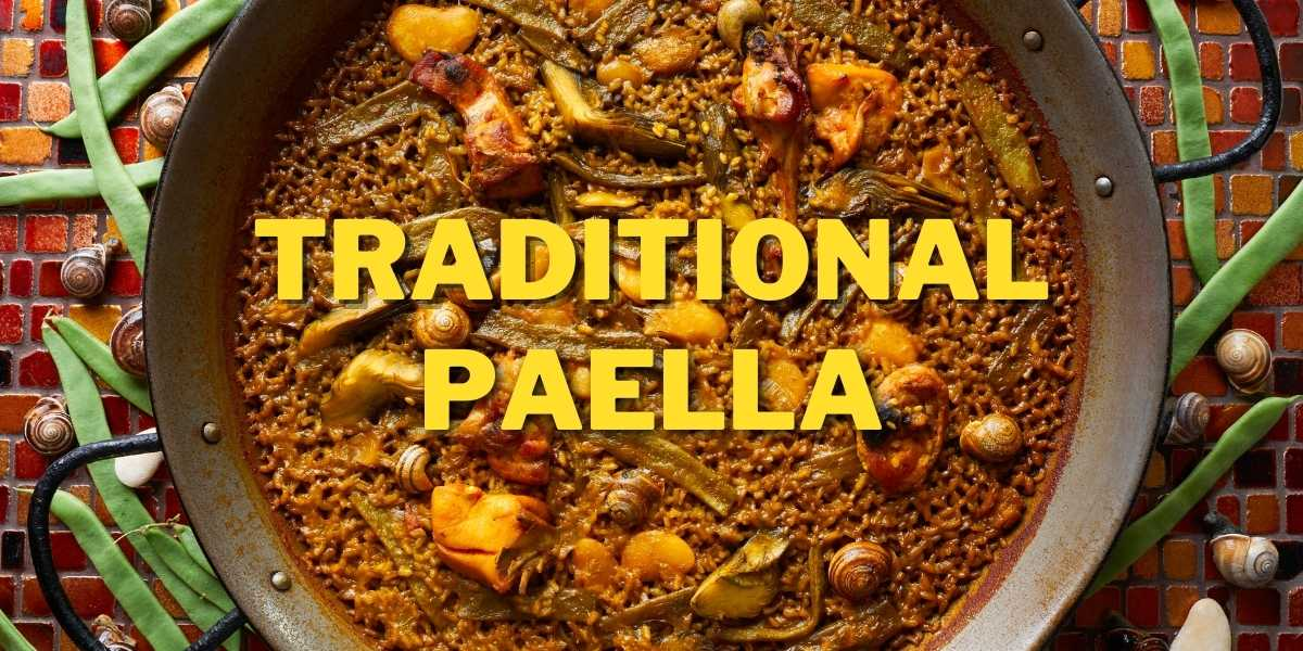 Traditional Spanish paella in paella pan rabbit meat, rice, green beans, and more.