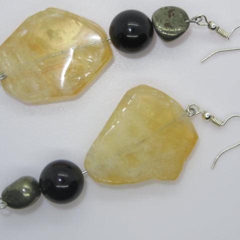 Image of Citrine Tourmaline and pyrite show the upside.