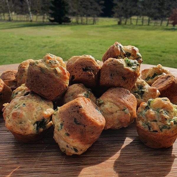 Toddler-friendly muffins made with lots of cheese and organic spinach