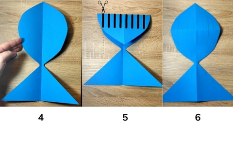 Folded and cut fish shaped paper