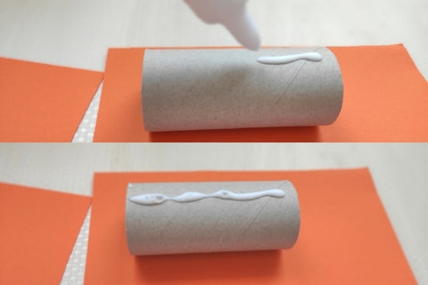 Putting glue on the toilet paper roll