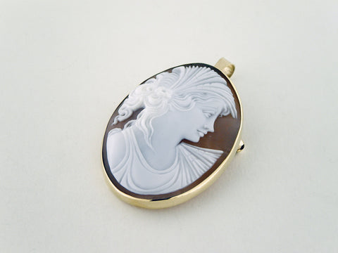 Gold cameo brooch and pendant