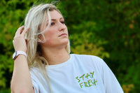 girl wearing fresh waves t shirt from kealoha