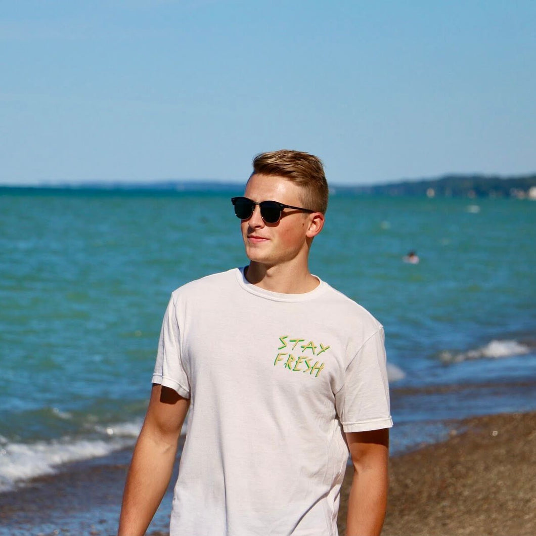 surfer wearing great lakes conservation shirt