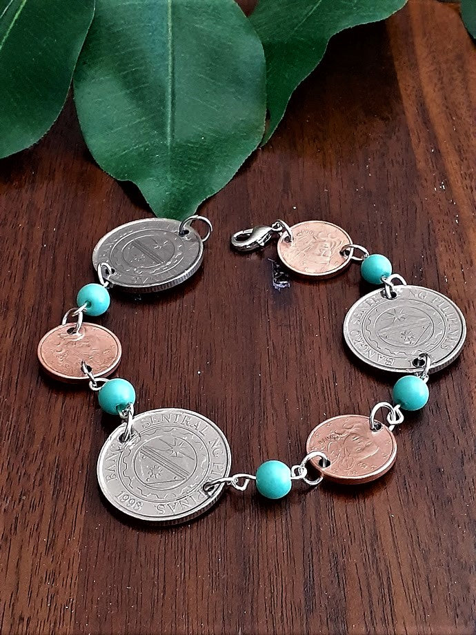 International Coin Bracelet With Light Blue Beads