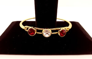 This bracelet has a gold finish and is 8 inches in diameter.