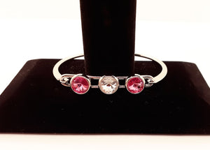 This bracelet has a rhodium finish and is 7 inches in diameter.