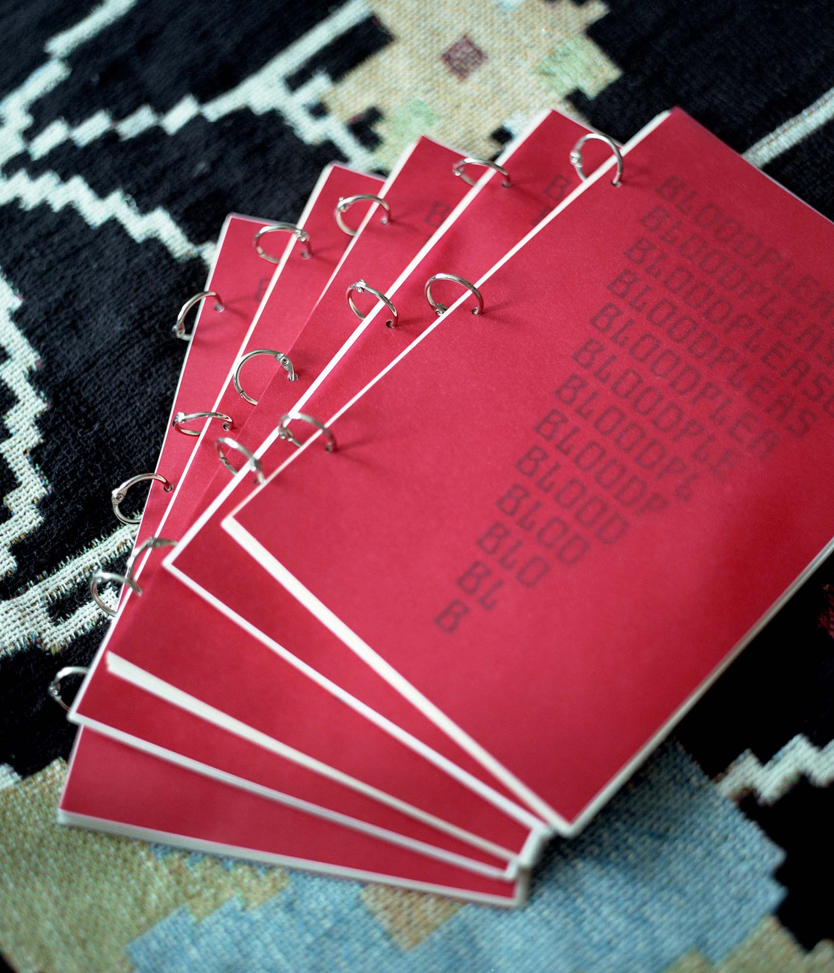 """pile of """"blood pleasure"""" books laid out on a carpet"""