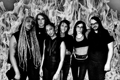 black and white band photo of listless with flames in the background