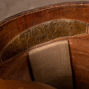 A close up image showing the makers name stamped into the leather inside of the pair of brown leather polo boots, made for Earl Spencer, Althorp Estate.