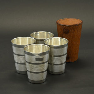 Pigskin cased set of four hunting beakers c.1930