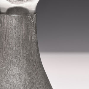 Close up of the hallmark on silver 'bark finish' decanter by House of Lawrian, London 1973. Detail of engraved silver bark finish.